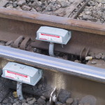 Application of two Tiefenbach wheel detectors to report alternate routing, used to monitor/reports movements at a switch.